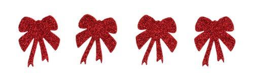 Etiquetas engomadas rojas de la cinta del día de fiesta del brillo en un fondo blanco Imagenes de archivo