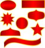 Etiquetas engomadas y banderas de oro rojas Imágenes de archivo libres de regalías