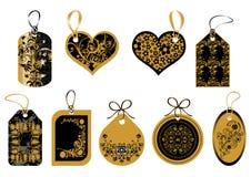 Etiquetas no ouro e em cores pretas Imagens de Stock Royalty Free
