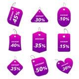Etiquetas púrpuras - descuento Foto de archivo libre de regalías