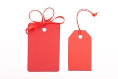 Etiquetas rojas del regalo Foto de archivo libre de regalías