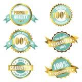 Etiquetas superiores de la garantía de calidad del oro Imágenes de archivo libres de regalías