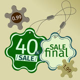 Etiquetas verdes da venda dentro  Imagem de Stock Royalty Free
