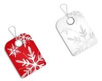 Etiquetas vermelhas do White Christmas Fotografia de Stock