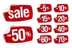 Etiquetas vermelhas para a venda do disconto Fotografia de Stock Royalty Free