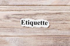 Etiquette of the word on paper. concept. Words of etiquette on a wooden background royalty free stock image