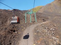 Cable car, Etna. Etna is an active stratovolcano on the east coast of Sicily, Italy. It is one of the world's most active volcanoes stock photography