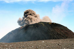 Etna crater erupting in daytime Royalty Free Stock Image