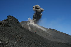 Etna erupting with photographer. Lex Schmidt taking pictures of south east crater of Etna Stock Photography