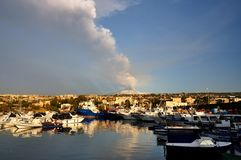Etna eruption from harbour Stock Photo