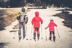 Family skiing on the snow on Mount Etna in Sicily royalty free stock photo