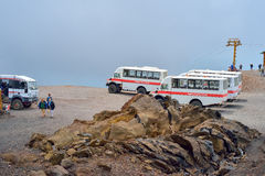 ETNA, ITALY - AUGUST, 2015: Tourists going up the Etna active volcano on big 4x4 buses in August, 2015 in Sicily Island, Italy. Stock Images