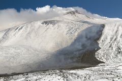 Etna lava on the snow in Valle del Bove Royalty Free Stock Photo