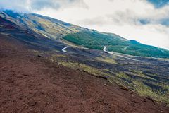 Etna national park landscape, Sicily. Road in the middle of volcanic mountains royalty free stock photos