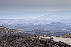 Etna. Panoramic view from the top of Mount Etna in Sicily, Italy, the highest active volcano in Europe, in the background the Mediterranean Sea and the city of Stock Images