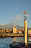 Etna with the smoking peak above the Sicilian town Royalty Free Stock Image