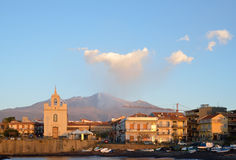 Etna with the smoking peak above the Italian town Stock Photo