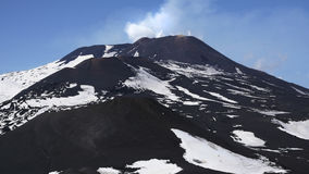 Etna in sunny day. The big crater of Etna mountain is little bit smoking Royalty Free Stock Photo