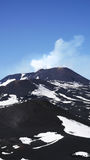 Etna in sunny day. The big crater of Etna mountain is little bit smoking Stock Images