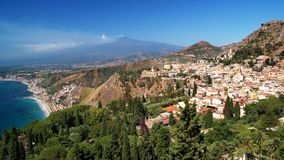 Etna and Taormina. The famous view of Etna volcano from historical city Taormina, Sicily Royalty Free Stock Photography