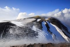 Etna Volcan-Summit crater in snowy landscape stock photo