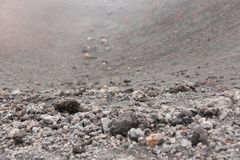 The Etna Volcano. Black Volcanic Earth, Volcanic Lava and Stones. Dense Fog on Mount Etna. Place for Text. The island of Sicily,. Italy stock image