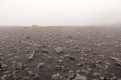 The Etna volcano. The Etna volcano crater. Black Volcanic Earth, Volcanic Lava and Stones. Dense Fog on Mount Etna. Place for. Text. The island of Sicily, Italy stock photos