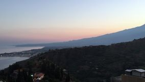 Etna volcano an its sea at sunset stock video footage