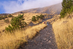 Etna volcano, Sicily, Italy. Tourist hiking on a trail on the Etna volcano, Sicily, Italy Stock Images