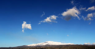 Etna volcano, with snow, front view Stock Photo