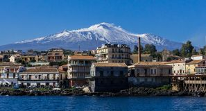 The Etna volcano whit snow seen from the sea stock photography