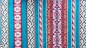 Etniczni wzorów lampasy z wzoru kolorowym tłem obraz royalty free