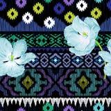 Etniczny bezszwowy wzór z kwiatami ilustracji