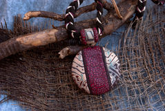 Etnika. African jewelry necklace with wooden branch. Handmade jewelry tribal of polymer clay royalty free stock photos