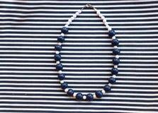 Etnika. Aquamarine jewelry. Beads of polymer clay. Handmade. Sea, marine background stock photography