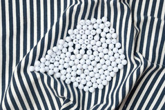 Etnika. Background with objects. Striped fabric with pile of white beads. Sea wallpaper stock image