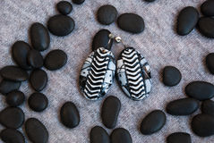 Etnika. Black and white jewelry earrings on grey fabric with small black stones. Handmade jewelry of polymer clay stock images
