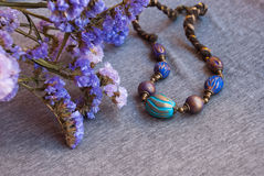 Etnika. Bohemian jewelry necklace indian with violet flowers. Handmade beads inoriental style of polymer clay stock images