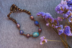 Etnika. Bohemian jewelry necklace indian with violet flowers. Handmade beads inoriental style of polymer clay royalty free stock images
