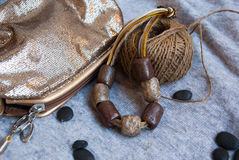 Etnika. Bohemian jewelry necklace with small gold bag and decorative cord. Handmade jewelry of polymer clay stock photos