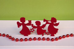Etnika. Chrictmas composition with angels and  red garland. Handmade new year card, background Stock Photo