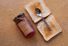 Etnika. Concept food with strawberry homemade jam and toasts with teaspoon. Top view. Still life royalty free stock photography