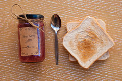 Etnika. Concept food with strawberry homemade jam and toasts with teaspoon. Top view. Still life.Food art stock photo