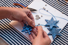 Etnika. Creative doy hobby. Preparation for christmas making handmade snowflake decoration ornament from polymer clay. New year tree decoration.Image with woman Royalty Free Stock Images
