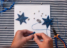 Etnika. Creative doy hobby. Preparation for christmas making handmade stars decoration ornament from polymer clay. New year tree decoration.Image with woman Stock Images