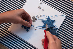 Etnika. Creative doy hobby. Preparation for christmas making handmade stars decoration ornament from polymer clay. New year tree decoration.Image with woman Royalty Free Stock Photography