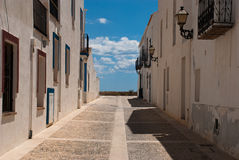 Etnika. Desert street on Tabarca Island Spain with blue sky and beautiful clouds stock images