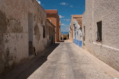 Etnika. Desert street on Tabarca Island Spain with blue sky and beautiful clouds stock photography