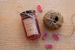 Etnika. Ecological homemade strawberry jam in glass jar with rope and marmalades on wood. Food still life top view stock photo