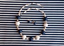 Etnika. Elegant beads and earrings scandinavian style. Marine jewelry. Handmade jewelry of polymer clay royalty free stock photo